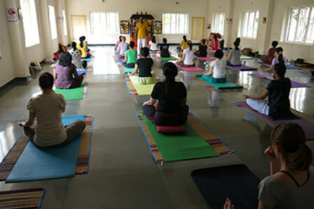 "<div style=""font-family: catamaran; color:#ffffff"">Sivananda Yoga Vedanta Centre</br><span style=""font-size: .8em"">Chennai (Madras) 
