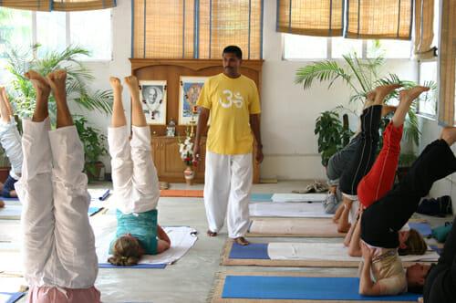 "<div style=""font-family: catamaran; color: #ffffff;"">Sivananda Yoga Vedanta Centre Nataraja</br><span style=""font-size: .8em;"">Kailash, New Delhi   India</span></div>"